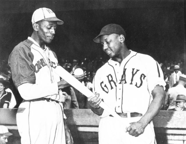 KANSAS CITY - 1942.  Satchel Paige of the Monarchs talks with Josh Gibson of the Homestead Grays before a game in Kansas City in 1941.  (Photo by Mark Rucker/Transcendental Graphics, Getty Images)